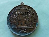 Medalis.numeruotas
